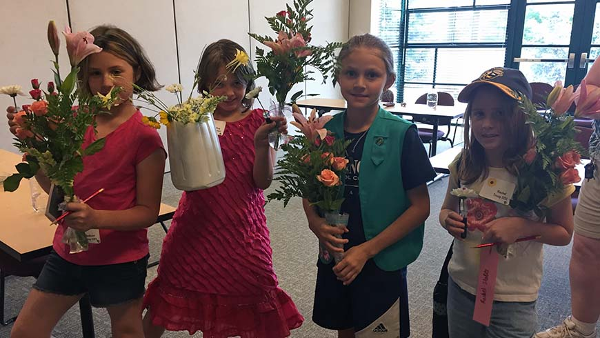 girl scouts with flowers