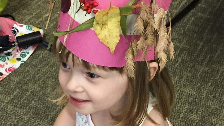 girl wearing nature crown
