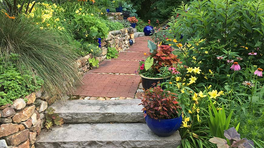 home landscape with steps and sidewalk