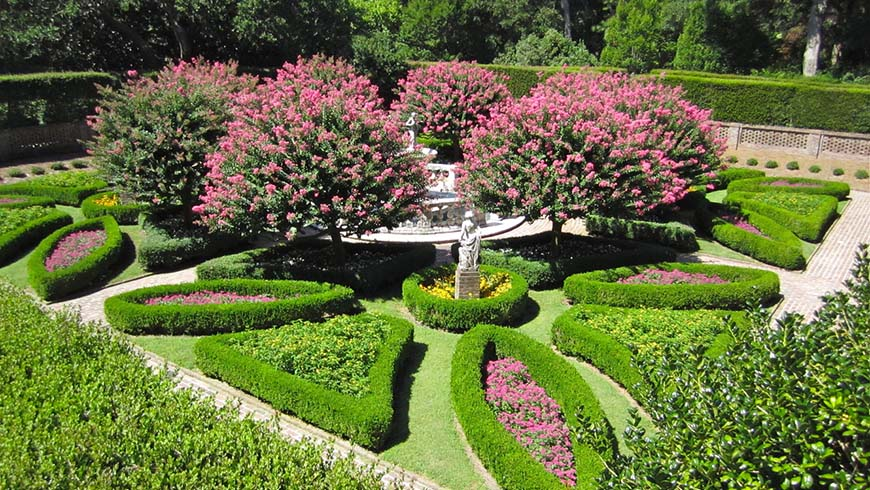 formal garden scene with fountain and crepe myrtles