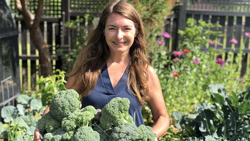 Brie Arthur with a vegetable garden harvest