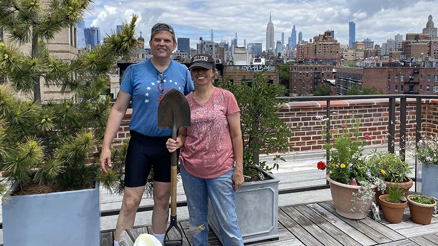 Scott and Daryl in a garden on top of a New York City building